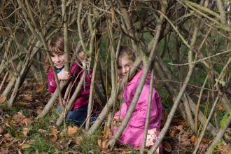 children in a willow tunnel