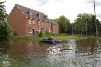Flooding of cars and houses caused by bad floodplain management